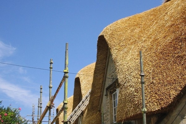 Thatching Stage 6 - Dressing and Sweeping the Roof